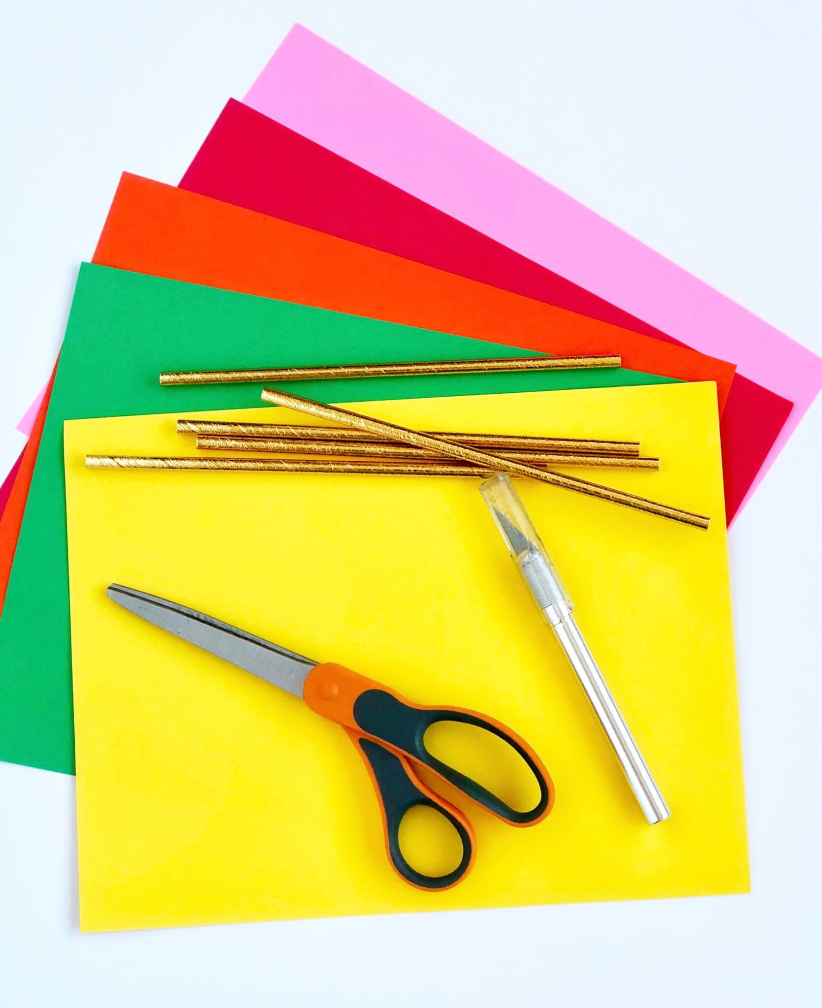 Craft supplies list with scissors and X-acto knife