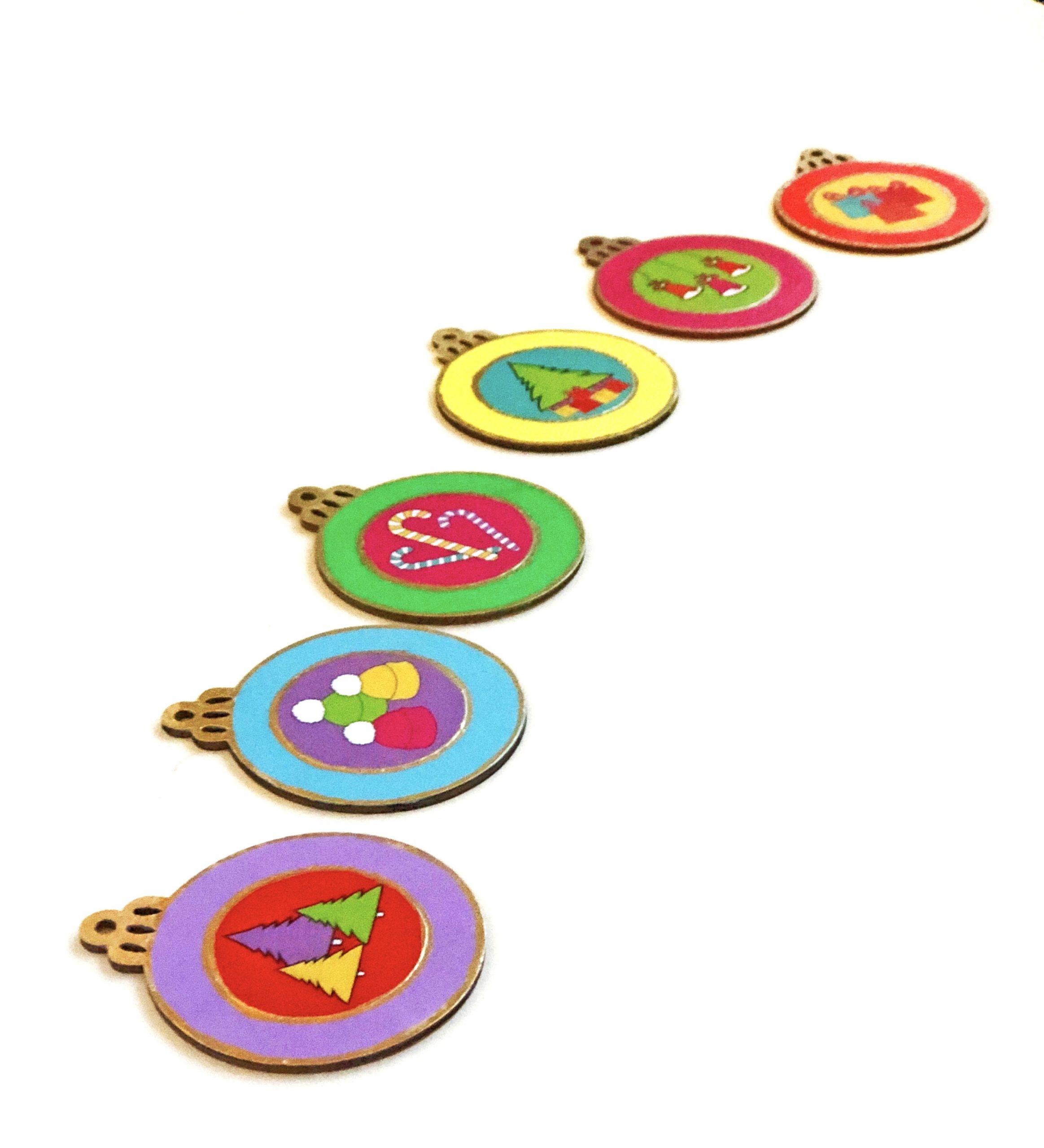DIY decoupage ornaments in rainbow colors